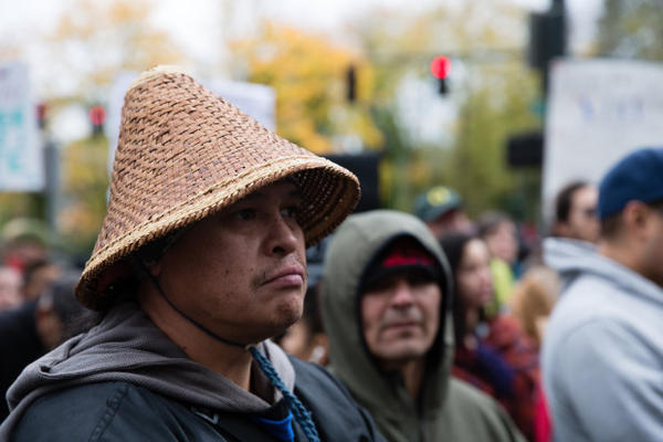 <p>Tiwani Sahme wears a Columbia river cedar hat. Sahme participated in the protests at Standing Rock along with other members of the Warm Springs canoe family. Sahme says he will use the lessons he learned there to fight plans for a Nestle bottled water facility in the Columbia Gorge.</p>