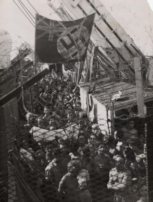 Jewish refugees, having been forced off <em>Exodus 1947</em> in Haifa, Palestine, wait aboard the British prison ship <em>Runnymede Park</em> on Aug. 22, 1947. In protest, the prisoners painted a swastika on top of the Union Jack.