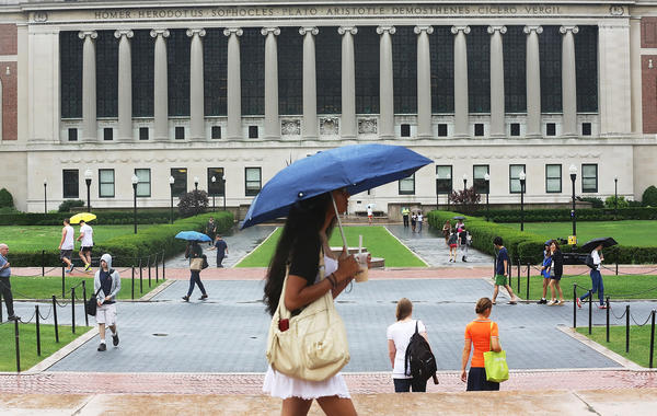 People walk on the Columbia University campus in New York City on July 1, the day the federal student loan interest rate hike kicked in.