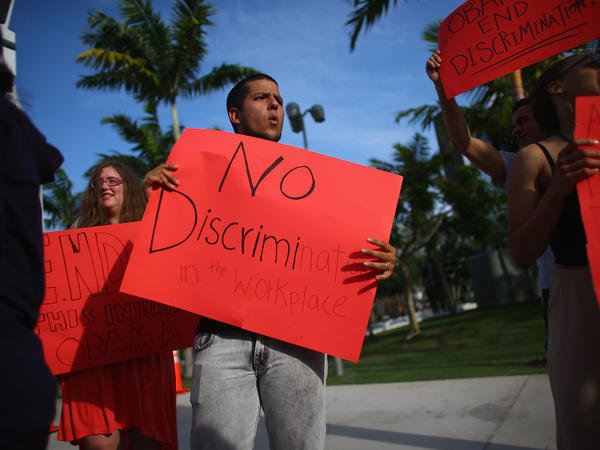 Esteban Roncancio and other protesters call for executive action on workplace discrimination for LGBT Americans in Miami.