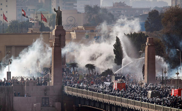 In January 2011, riot police forced anti-government protesters back across the Kasr Al Nile Bridge as they attempted to get into Tahrir Square.