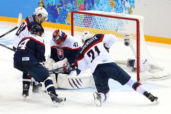 James van Riemsdyk #21 of United States shoots the puck against Jaroslav Halak #41 of Slovakia during the Men's Ice Hockey Preliminary Round Group A game on day six of the Sochi 2014 Winter Olympics at Shayba Arena on February 13, 2014 in Sochi, Russia. (Streeter Lecka/Getty Images)