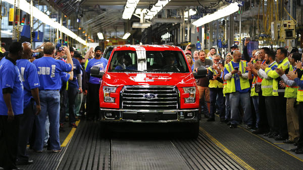 A 2015 F-150 rolls off the assembly line at the Dearborn Truck Plant in Dearborn, Mich. The aluminum-sided F-150 could set a new industry standard — or cost the company its pickup truck crown.