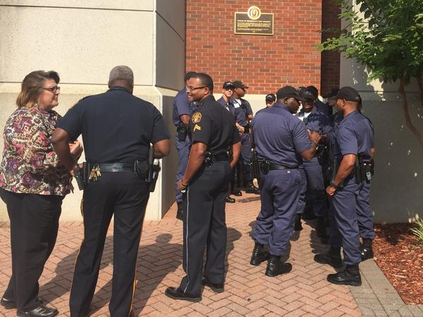 "Montgomery police cadets gathered outside the Rosa Parks Museum before a tour.  The tour is part of a course called ""Policing in a Historic City: Civil rights and Wrongs in Montgomery."""