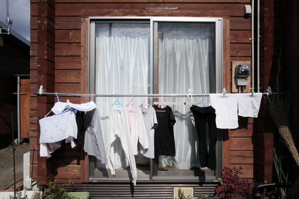Clothes hang outside the temporary housing in Date city, Fukushima prefecture. In 2011, people would not hang their laundry outside due to the fear of radiation exposure, but now it is common to see.
