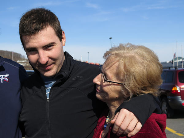 Nikko Adam, 22, gets a hug from his mother, Patti Trabosh, after his family picked him up from his sober living facility for a weekend outing.