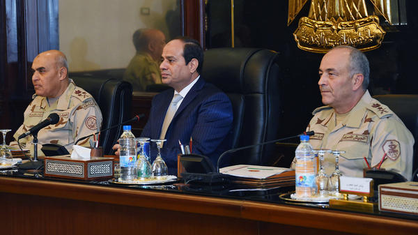 Egypt's President Abdel-Fattah el-Sissi (center) chairs a meeting of the Supreme Council of the Armed Forces in Cairo last November. As head of the military, Sissi was behind the coup that toppled Egypt's elected government in 2013.