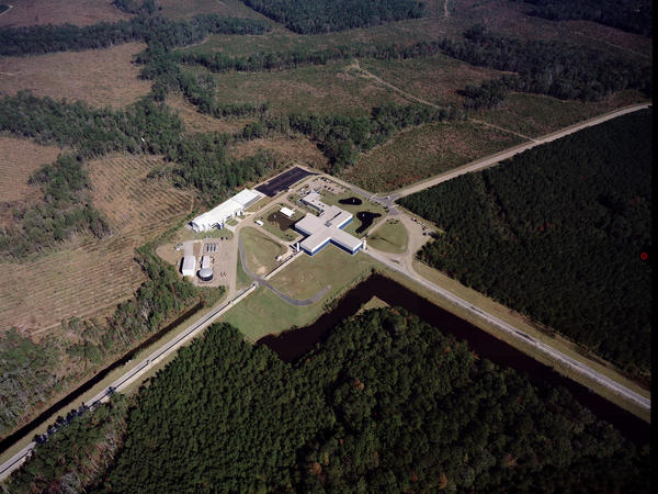 The Laser Interferometer Gravity-Wave Observatory looks for tiny changes in the length of the structure's 2.5-mile-long arms. There are two detectors: one in Washington state and one in Louisiana (pictured). This photo was taken before severe flooding that has deluged a large part of the state, including where the observatory is located. Officials there report the detector is fine.