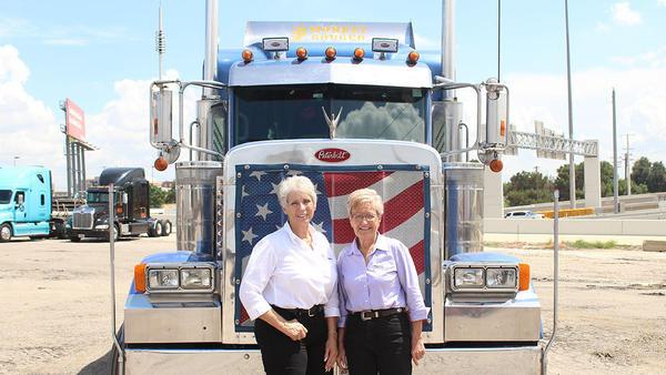 Idella Hansen and Sandi Talbott, at an annual trucking convention in Dallas.