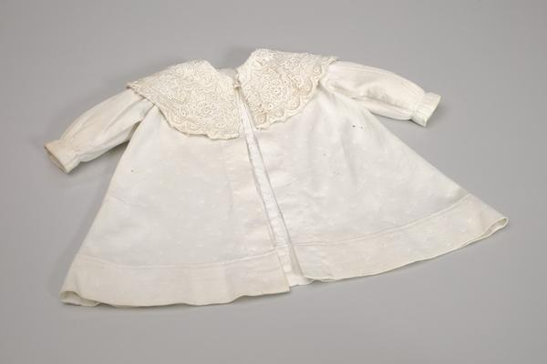 A child's coat and bonnet, belonging to Delores Eugenia Hardiman.