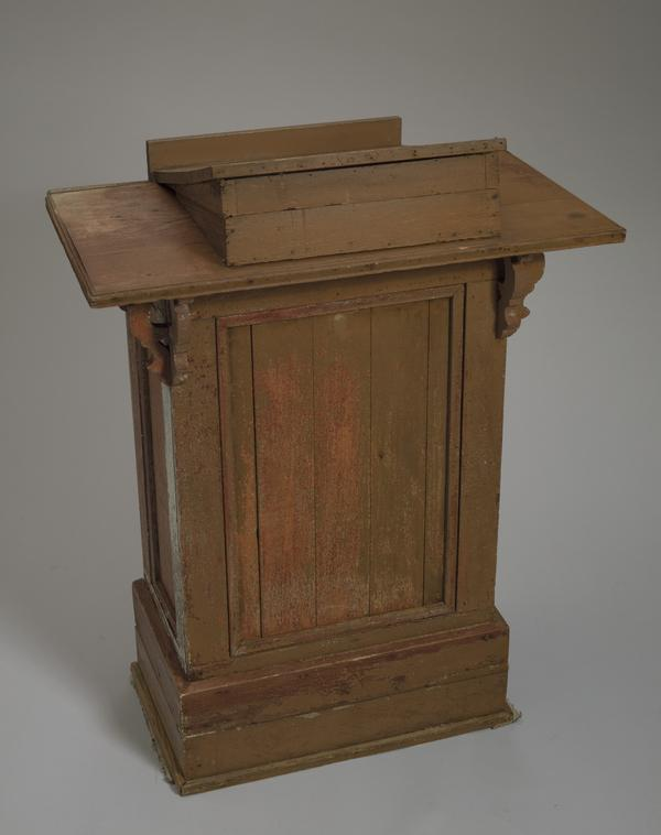Podium used at the Wayman Chapel A.M.E. Church in Lyles Station, Indiana. The podium is made of wood and has metal nails, hinges and cabinet hardware.