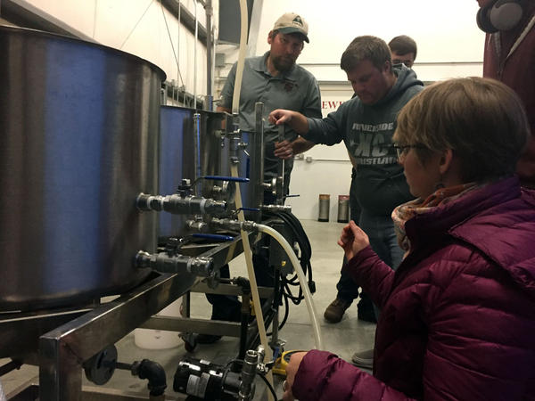 Megan Myers, right, works with classmate Caleb Bos to make wort during a lab class that's part of the craft brewing program at Central Washington University. Both had experience brewing beer at home before they applied for the program.
