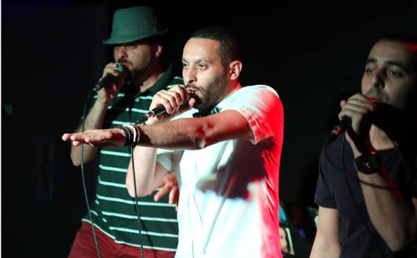 Tamer Nafar (center), performs with the hip-hop group DAM. The members are all Arabs who are citizens of Israel, and some of their lyrics are harshly critical of the state. They see it as artistic freedom, while Israel's culture minister says such language could incite violence.
