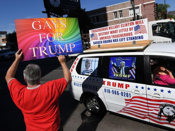 Supporters of Republican presidential hopeful Donald Trump, including gay rights groups, protest against alleged bias outside the CNN offices in Hollywood, California on Oct. 22, 2016.