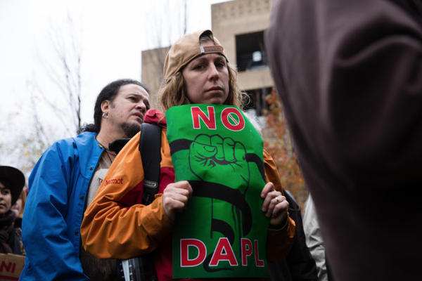 <p>Several hundred people joined the protest Monday outside an Army Corps of Engineers building in downtown Portland</p>