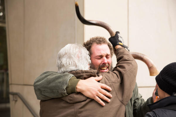 <p>Occupation supporter Brand Nu Thornton, left, raises his shofar and hugs fellow supporter John Lamb after seven occupiers of the Malheur National Wildlife Refuge in eastern Oregon were found not guilty.</p>