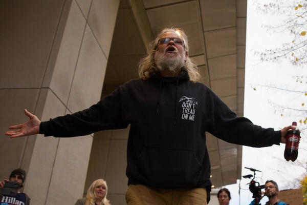 "<p>An occupation supporter shouts ""Free the Hammonds"" outside the federal courthouse in Portland. The 41-day occupation of the Malheur National Wildlife Refuge was partly driven by the resentencing of Harney County ranchers Dwight and Steven Hammond.</p>"