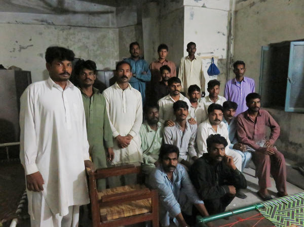 Some of the men imprisoned by a criminal gang in Pakistan's illicit kidney trade return to the apartment in Rawalpindi where they were held by force.