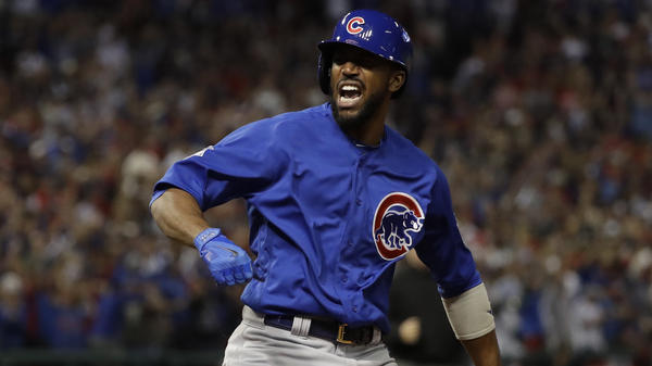 The Chicago Cubs' Dexter Fowler reacts after hitting a home run during the first inning of Game 7 of the World Series against the Cleveland Indians Wednesday in Cleveland.