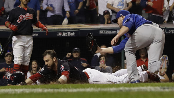 The Cleveland Indians' Jason Kipnis scores, evading a tag by the Chicago Cubs' Jon Lester during the fifth inning of World Series Game 7 on Wednesday.