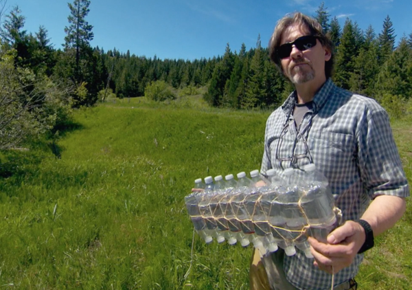 <p>Oregon Fish and Wildlife biologist Simon Wray holds a homemade float consisting of homemade water bottles, string and duct tape. He's been using homemade equipment to study turtles in the Rogue Valley for 23 years.</p>