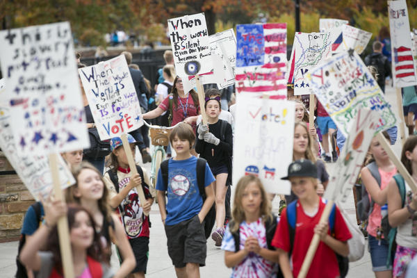 Ruby Lortie (center, wearing black), marches to get out the vote with other fifth-grade students from Boulder Community School of Integrated Studies in Boulder, Colo.