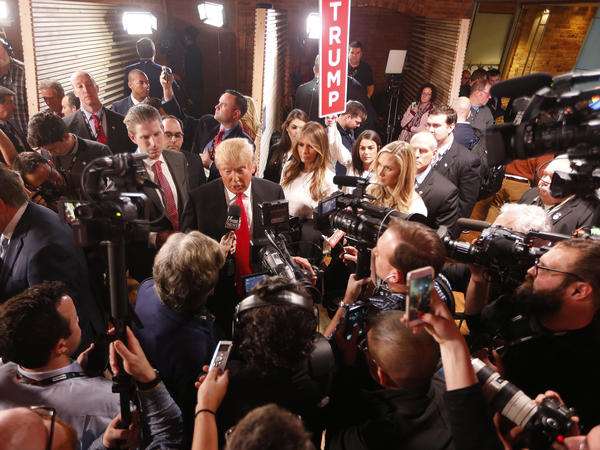 Donald Trump speaks to members of the media in the spin room after the Republican presidential debate Feb. 13, in Greenville, S.C.