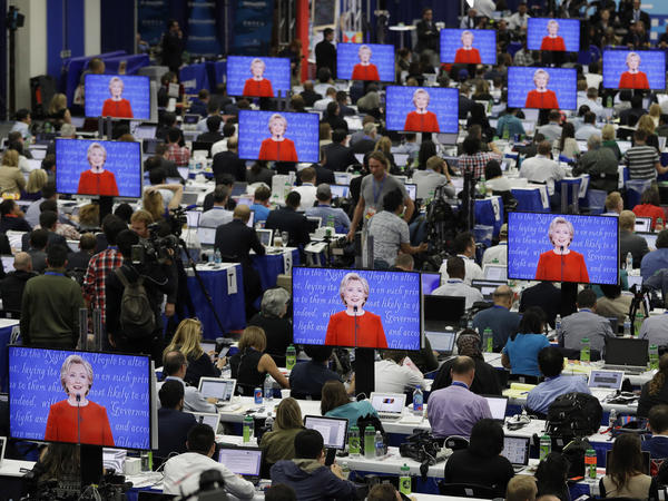 Hillary Clinton is seen on screens in the media center Sept. 26, during her debate with Donald Trump at Hofstra University in Hempstead, N.Y.