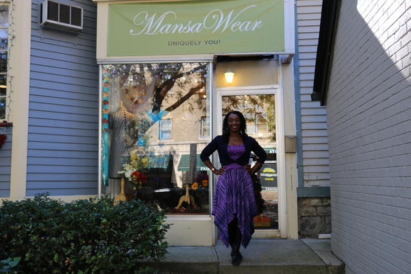 Nita Brown stands outside MansaWear, a custom-clothing shop on Park Avenue in Rochester. Though she would like to see the tax burden lowered, Brown says she is not willing to sacrifice public services.