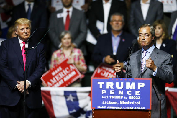 Donald Trump listens to United Kingdom Independence Party leader Nigel Farage during a campaign rally on Aug. 24, in Jackson, Miss. Farage was a leader of the pro-Brexit campaign in Britain.