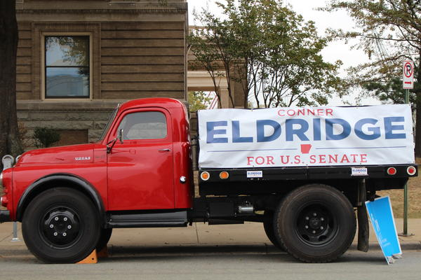 U.S. Senate candidate Conner Eldridge (D) has made this red truck, outside the Pulaski County Regional Building, a symbol of his campaign.