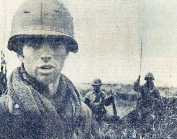 Army Specialist Jim McGough with members of his unit in 1971. Then 19, he was photographed by a columnist from <em>The Des Moines Register</em>.