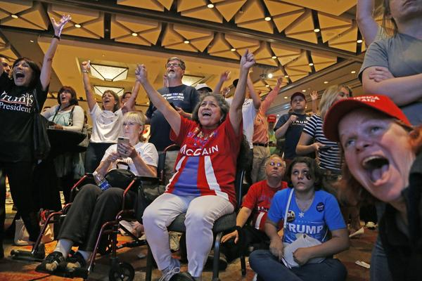 Supporters of Trump celebrate election results in Phoenix on Tuesday.