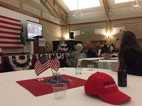 Donald Trump supporters watch election returns at a victory party in Spokane Valley, Washington.
