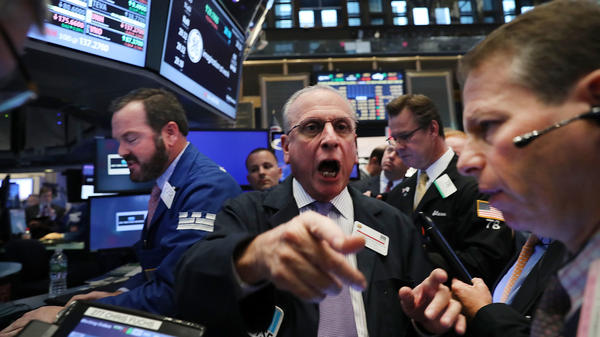 Traders work on the floor of the New York Stock Exchange Wednesday morning, after Donald Trump won a major upset in the presidential election.