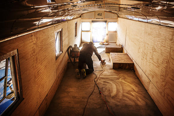 <p>Volunteers with the Climate Action Coalition overhaul the inside of a 20-year-old school bus to transform it into a shelter for protesters at the Standing Rock Reservation.</p>