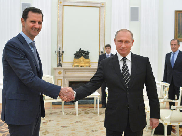 Syrian President Bashar Assad (left) and Russian President Vladimir Putin shake hands at the Kremlin in October 2015. U.S. President-elect Donald Trump faces many foreign policy challenges, which will include dealing with the war in Syria and friction with Russia.