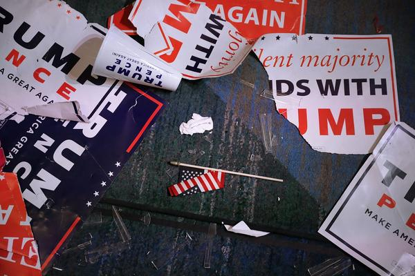 Campaign signs for Republican presidential nominee Donald Trump litter the floor of the room where he celebrated his victory at the New York Hilton Midtown in the early morning hours on Nov. 9, 2016 in New York. (Chip Somodevilla/Getty Images)