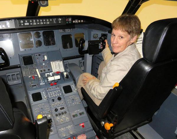 Central Washington University Professor Teresa Sloan in the aviation program's CRJ-200 turbojet flight simulator.