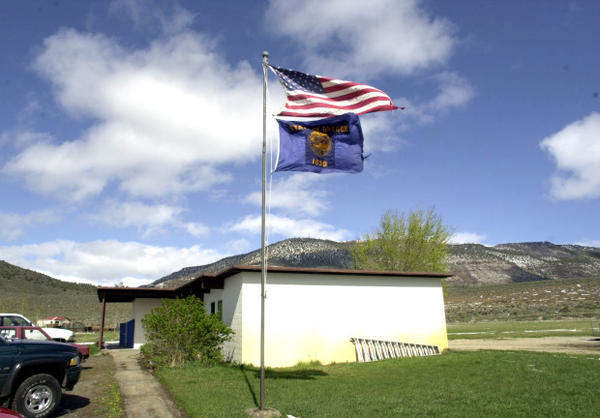 <p>The American and Oregon flags flap above the two-classroom Adel Middle School in the small south-central Oregon community of Adel, Oregon, April 15, 2004.</p>