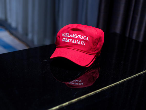 A stack of the Trump campaign's signature hats sit on a table during the election-night event held at the New York Hilton Midtown on Tuesday.