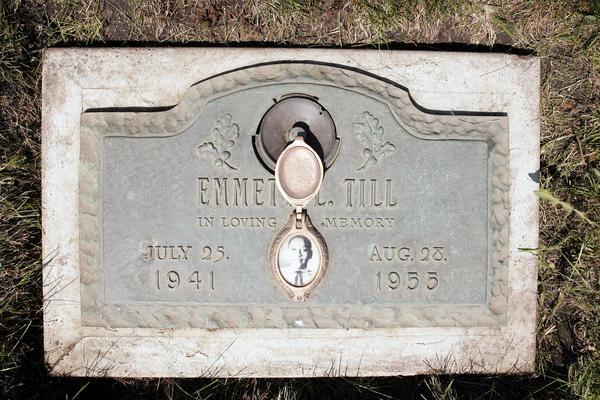 A plaque marks the grave site of Emmett Till at Burr Oak Cemetery in Alsip, Ill. Till died in a lynching in Mississippi in 1955. A decade prior, his father, Louis Till, was hanged after being convicted of rape and murder, but writer John Edgar Wideman believes he may have been framed.