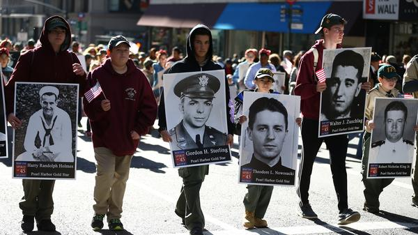 """People attend the Veterans Day Parade in New York City Thursday. Known as """"America's Parade,"""" it features over 20,000 participants, including veterans of numerous eras, military units, businesses and high school bands and civic and youth groups."""