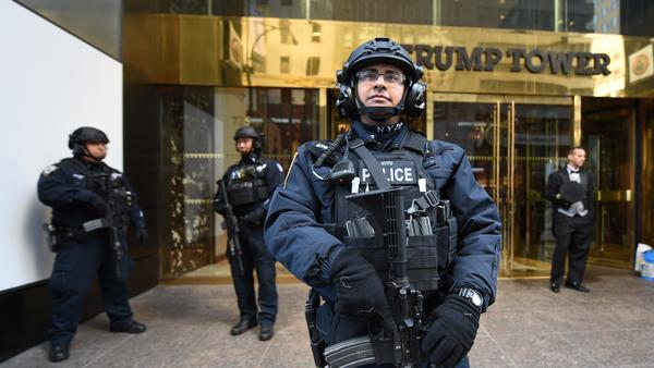 A member of the New York Police Department stands in front of Trump Tower to provide security to U.S. President-elect Donald Trump on Thursday in New York.