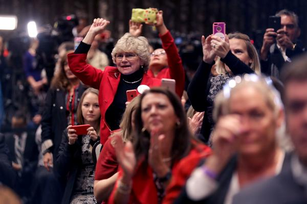 Invited guests cheer for Donald Trump during a campaign event Nov. 1 in Valley Forge, Pa.