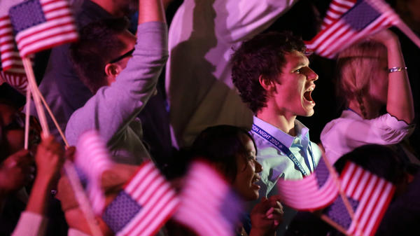 Young supporters cheer as they wait for President Obama at his election night party in 2012 in Chicago.