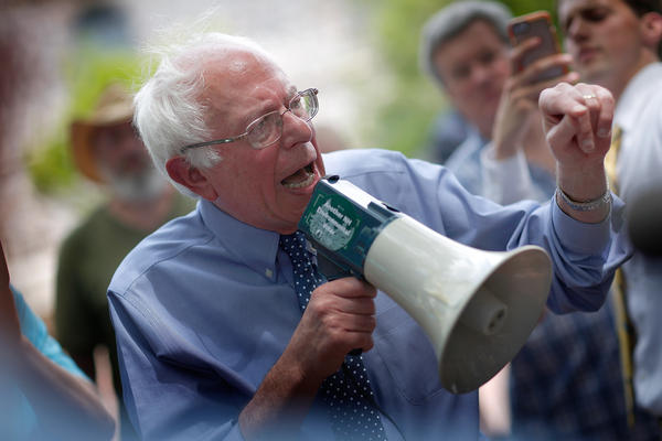 Democratic presidential candidate Sen. Bernie Sanders speaks to an overflow crowd through a megaphone after a campaign event May 27, 2015, at New England College in Concord, N.H.