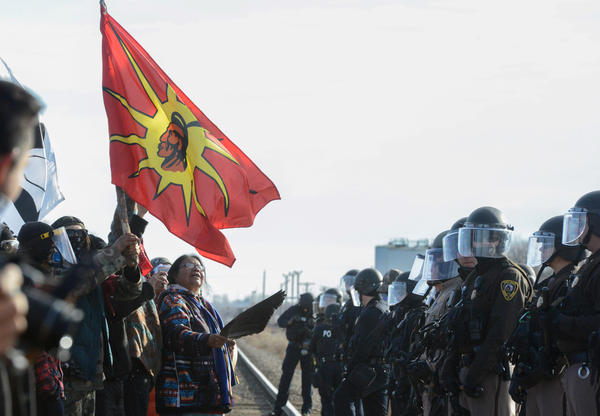Protesters have a standoff with police during a demonstration against the Dakota Access pipeline near the Standing Rock Indian Reservation in Mandan, N.D., on Nov. 15.