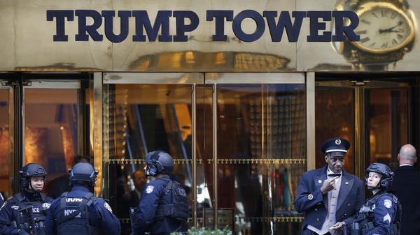 Law enforcement guards an entrance to Trump Tower in New York City, where President-elect Donald Trump is holding meetings with possible Cabinet picks.