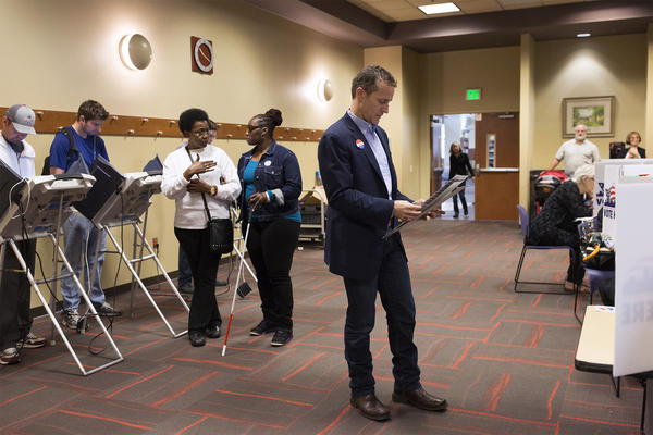 Gubernatorial candidate Eric Greitens looks at his ballot before sitting down to vote at the St. Louis Public Library in the Central West End on Tuesday.